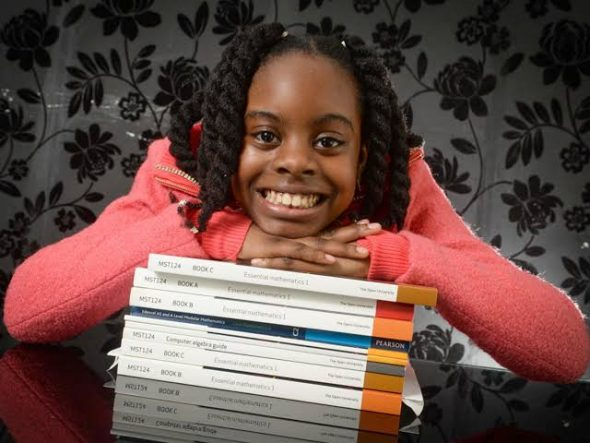 A 14 years old Nigerian Ph'd Holder 🎓. Plans to own her bank when she's 15.