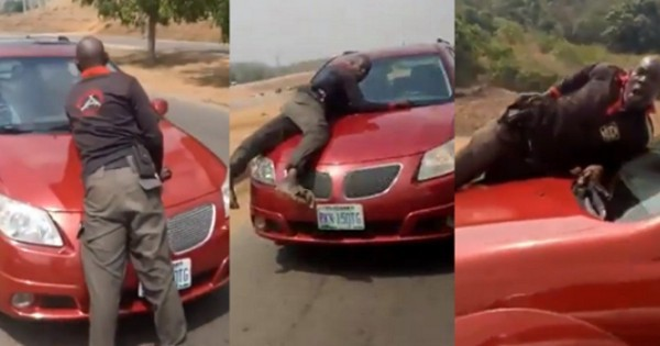 Policemen Spotted On Bonnet Of Speeding Vehicle Of Lady Who Refused To Stop For Security Operatives Who Were Not Wearing Face Masks