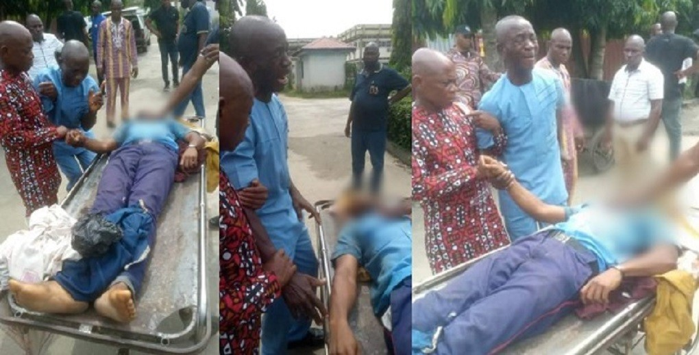 Heartbreaking photos of a father weeping after seeing the body of his son allegedly shot dead by police officer in Rivers State